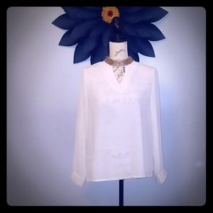 Women's sheer cream blouse with gold neck beading